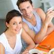Young couple having breakfast at home — Stock Photo