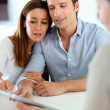 Young couple meeting financial adviser — Stock Photo