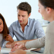 Couple signing real-estate contract — Stock Photo
