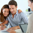 Foto Stock: Couple signing real-estate contract
