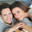 Upper view of sweet couple sitting in sofa — Stock Photo