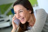 Cheerful brunette girl talking on mobile phone — Stock Photo