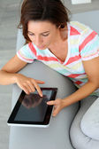Young woman websurfing on internet with tablet — Stock Photo