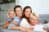 Portrait of family relaxing in sofa — Stock Photo