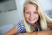 Portrait of smiling blond teenager — Stock Photo