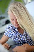 Portrait of teenager using digital tablet — Stock Photo