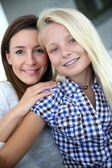Portrait of young woman with teenager — Stock Photo