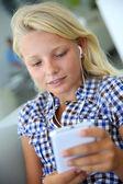Portrait of teenager using smartphone — Stock Photo