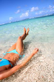 Closeup of woman body bathing in Caribbean sea — Stock Photo