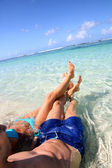 Couple relaxing in Carribean sea water — Stock Photo