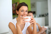 Portrait of young woman having breakfast — Stock Photo