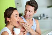 Cheerful couple enjoying breakfast time — Stock Photo