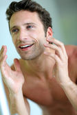 Closeup of handsome guy cleansing his face — Stock Photo