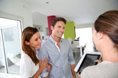 Couple visiting home with real-estate agent — Stock Photo
