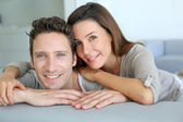Portrait of sweet couple sitting in sofa — Stock Photo