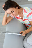 Upper view of woman websurfing on internet — Stock Photo