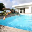 Stock Photo: Mdiving in private swimming-pool