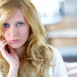Portrait of blond woman with upset look — Stock Photo #27920465