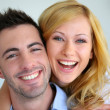 Cheerful in love couple at home — Stock Photo #27920583