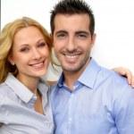 Cheerful couple looking at camera — Stock Photo