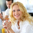 Beautiful blond girl drinking coffee for breakfast — Stock Photo