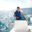 Young couple navigating on a yacht in caribbean sea — Lizenzfreies Foto