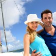 Stock Photo: Smiling rich young couple on a sailboat in Caribbean sea