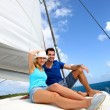 Stock Photo: Cheerful couple cruising on catamarin Caribbesea