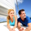 Smiling couple relaxing on a yacht by sunny day — Stock Photo