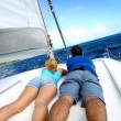 Stock Photo: Couple relaxing on sailing boat while cruising