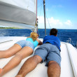 Couple relaxing on a sailing boat while cruising — Stock Photo