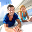 Stock Photo: Cheerful couple cruising on sail boat