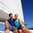 Portrait of couple sitting on the top of sailing boat — Stock Photo