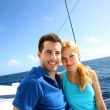 Portrait of couple sitting on the top of sailing boat — Stock Photo #27922257
