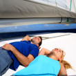 Young couple relaxing on sailboat deck — Stock Photo