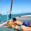 Young couple relaxing at the front of yacht — Stock Photo