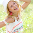 Stock Photo: Smiling girl in countryside wearing hat