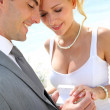 Bride and groom exchanging wedding rings — Stock Photo