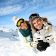 Stock Photo: Couple of skiers laying down in snow