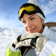 Portrait of cheerful blond woman at ski resort — Stock Photo #27923683