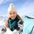 Portrait of beautiful woman in snowy mountain — Stock Photo