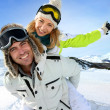 Cheerful snowboarder holding girlfriend on his back — Stock Photo