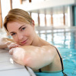 Blond woman relaxing in spa pool — Stock Photo #27924129