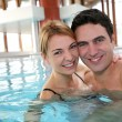 Couple enjoying bathtime in spa resort — Stock Photo #27924167