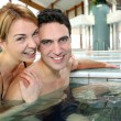 Stock Photo: Couple enjoying bathtime in spresort