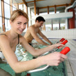 People exercising with aquatic bikes in spa center — Stock Photo