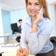 Stock Photo: Smiling businesswomtalking on mobilephone