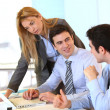 Stock Photo: Businessteam working together on project