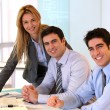 Foto Stock: Portrait of cheerful business team