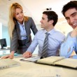 Business team working on sales results — Stock Photo